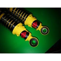 puch modelos de campo amortiguadores con cuerpo amarillo y muelle cromado